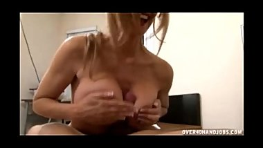 Sexy MILF rubs cock with her tits
